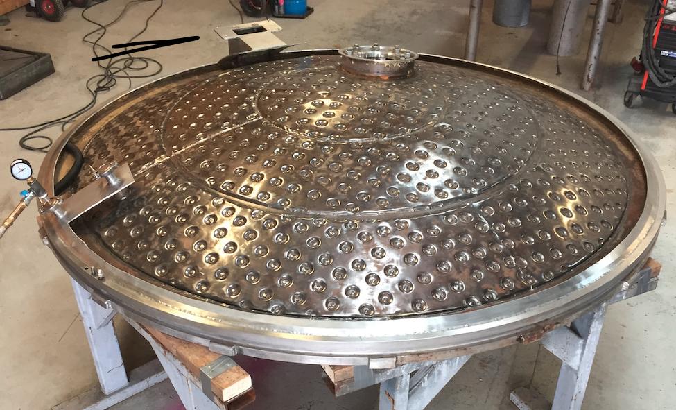 Reparation af dæksel med kølekappe